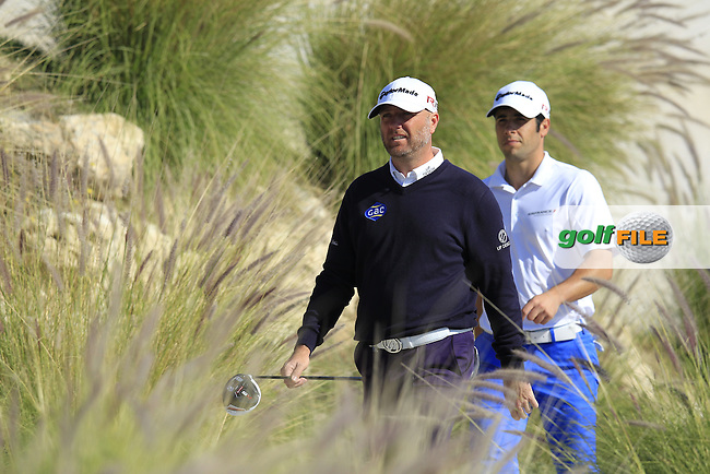 Graeme STORM (ENG) and Adrian OTAEGUI (ESP) walk off the 11th tee during Wednesday's Round 1 of the 2015 Commercial Bank Qatar Masters held at Doha Golf Club, Doha, Qatar.: Picture Eoin Clarke, www.golffile.ie: 1/21/2015