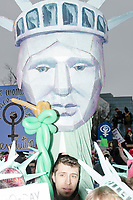 A Statue of Liberty puppet is seen in the crowd as people gather in the National Mall area of Washington, DC, for the Women's March on Washington protest and demonstration in opposition to newly inaugurated President Donald Trump on Jan. 21, 2017.