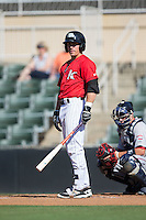 Danny Mendick (1) of the Kannapolis Intimidators looks to his third base coach for the signs during the game against the Greenville Drive at Intimidators Stadium on June 7, 2016 in Kannapolis, North Carolina.  The Drive defeated the Intimidators 4-1 in game one of a double header.  (Brian Westerholt/Four Seam Images)