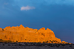 Storm clouds over a colorful sculpted Navajo Sandstone formation at sunset in the Head of Sinbad area of the San Rafael Swell in Utah.