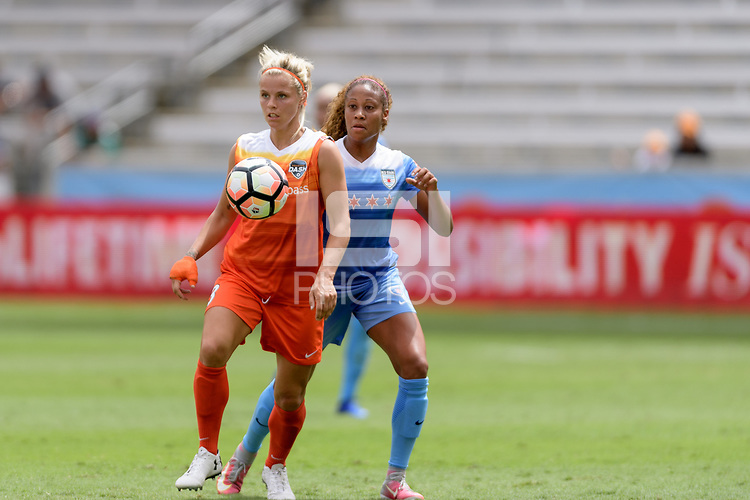 Houston, TX - Saturday April 15, 2017: Rachel Daly attempts to control a loose ball in front of Casey Short during a regular season National Women's Soccer League (NWSL) match between the Houston Dash and the Chicago Red Stars at BBVA Compass Stadium.