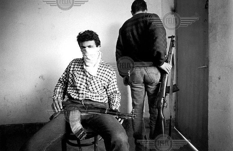 "©Francesco Cito/Panos Pictures..Shkoder, Albania. The young ""Cimi"" is locked up in his refuge and ready to defend himself from the revenge, because two years before he shot dead a man who was annoing him while playing pool."