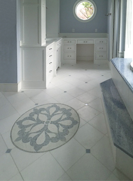 Custom, hand cut stone mosaic floral medallion, shown in Thassos and Celeste.<br /> -photo courtesy of Architectual Ceramics