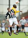 Pars' Ryan Thomson and Cowdenbeath's Joe Mbu challenge for the ball ...