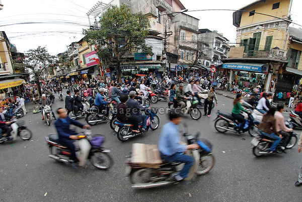 Asia, Vietnam, Hanoi. Hanoi old quarter. Typical motorbike traffic.