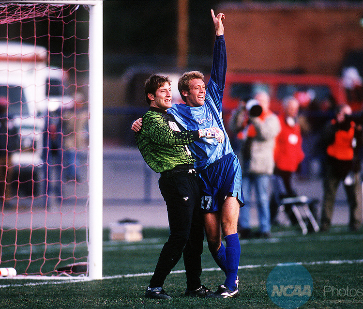 14 DEC 1997:  Defender Jimmy Conrad (17) of UCLA celebrates with teammate goalkeeper Matt Reis as the final whistle sounds at the 1997 Division I Men's Soccer Championships held at Richmond Stadium in Richmond, Virgina. UCLA defeated the University of Virginia 2-0 for the championship title. David Gonzales/NCAA Photos