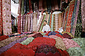 A uighur textile salesman at the Kashgar Sunday Bazaar.
