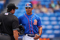St. Lucie Mets manager Luis Rojas (19) talks with umpire Mike Savakinas in between innings during a game against the Brevard County Manatees on April 17, 2016 at Tradition Field in Port St. Lucie, Florida.  Brevard County defeated St. Lucie 13-0.  (Mike Janes/Four Seam Images)