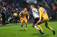 Bolton Wanderers' Craig Noone competing with Wigan Athletic's Kal Naismith<br /> <br /> Photographer Andrew Kearns/CameraSport<br /> <br /> The EFL Sky Bet Championship - Bolton Wanderers v Wigan Athletic - Saturday 1st December 2018 - University of Bolton Stadium - Bolton<br /> <br /> World Copyright © 2018 CameraSport. All rights reserved. 43 Linden Ave. Countesthorpe. Leicester. England. LE8 5PG - Tel: +44 (0) 116 277 4147 - admin@camerasport.com - www.camerasport.com