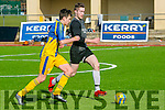 In Action Tralee Bay's Mossie Hogan and Windmill's  Brian Hair in the Denny Division 2B Tralee Bay V Windmill United at Mounthawk Park on Sunday