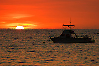 Fishing Boat Anchored In The Ocean At Sunset
