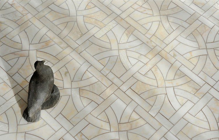 Gran Via, a waterjet mosaic shown in polished Cloud Nine, is part of the Miraflores collection by Paul Schatz for New Ravenna.