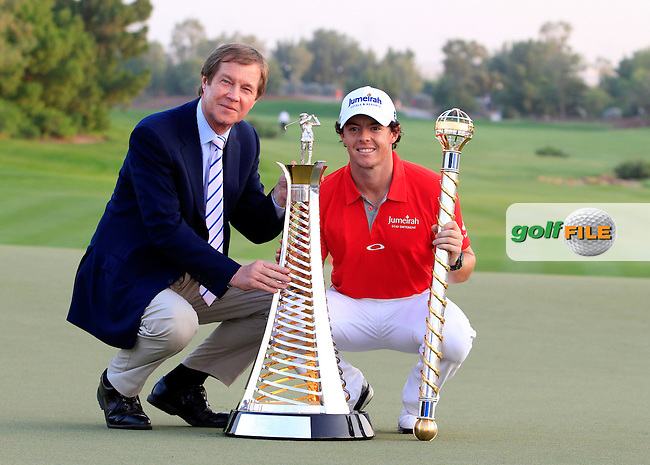 CEO of the European Tour George O'Grady and Winner Rory McIlroy (NIR) with the Race to Dubai Trophy and the DP World Tour Championship Trophy at the DP World Tour Championship, Jumeirah Golf Estates, Dubai, United Arab Emirates. 25/11/12...Photo www.golffile.ie