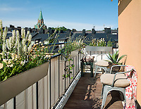 This Stockholm apartment's small balcony enjoys views over the neighbouring roof tops