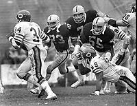 Chicago Bears Walter Payton running against the Oakland Raiders.., Odis McKinney, John Matuszak, and Matt Millen. (1981 photo/Ron Riesterer)