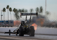 Feb 2, 2017; Chandler, AZ, USA; Heat waves are left in the path of NHRA top fuel driver Tony Schumacher as he races down track during Nitro Spring Training preseason testing at Wild Horse Pass Motorsports Park. Mandatory Credit: Mark J. Rebilas-USA TODAY Sports