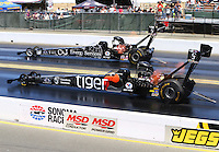 Aug 2, 2015; Sonoma, CA, USA; NHRA top fuel driver Larry Dixon (near) races alongside Dave Connolly during the Sonoma Nationals at Sonoma Raceway. Mandatory Credit: Mark J. Rebilas-