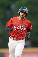 Right fielder Victor Acosta (11) of the Greenville Drive trots home after hitting a home run in a game against the Charleston RiverDogs on Friday, April 27, 2018, at Fluor Field at the West End in Greenville, South Carolina. Greenville won, 5-4. (Tom Priddy/Four Seam Images)