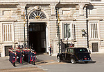 Soldiers in traditional dress uniform greet royal  car, Palacio Real royal palace, Madrid, Spain