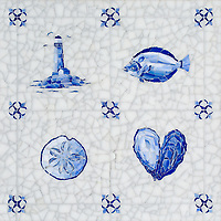 Delft, a hand-cut jewel glass mosaic, shown in  Opal Sea Glass™ with jewel glass Lapis Lazuli, Iolite, and Covelite.
