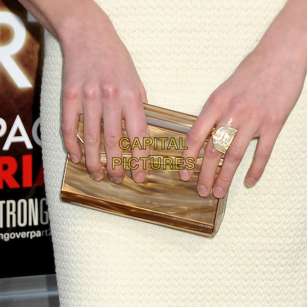 "YVONNE STRAHOVSKI's hand .""The Hangover Part II"" Los Angeles Premiere held at Grauman's Chinese Theatre, Hollywood, California, USA, 19th May 2011..2  detail gold clutch bag ring .CAP/ADM/BP.©Byron Purvis/AdMedia/Capital Pictures."
