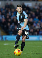 Matt Bloomfield of Wycombe Wanderers plays a pass during the Sky Bet League 2 match between Wycombe Wanderers and Oxford United at Adams Park, High Wycombe, England on 19 December 2015. Photo by Andy Rowland.