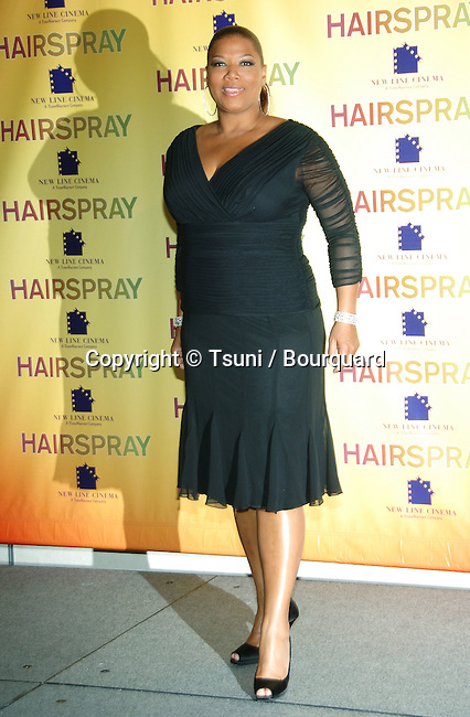 Queen Latifah  at the HAIRSPRAY Press Call at SHOWEST in Las Vegas.<br /> <br /> eye contact<br /> full lenght<br /> dark blue dress