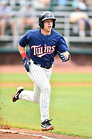 Elizabethton Twins shortstop Spencer Steer (31) runs to first base during a game against the Kingsport Mets at Joe O'Brien Field on July 6, 2019 in Elizabethton, Tennessee. The Twins defeated the Mets 5-3. (Tony Farlow/Four Seam Images)
