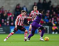 Lincoln City's Lee Frecklington vies for possession with  Grimsby Town's Mitch Rose<br /> <br /> Photographer Andrew Vaughan/CameraSport<br /> <br /> The EFL Sky Bet League Two - Lincoln City v Grimsby Town - Saturday 19 January 2019 - Sincil Bank - Lincoln<br /> <br /> World Copyright © 2019 CameraSport. All rights reserved. 43 Linden Ave. Countesthorpe. Leicester. England. LE8 5PG - Tel: +44 (0) 116 277 4147 - admin@camerasport.com - www.camerasport.com