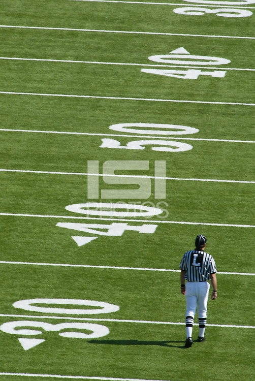 University of California vs UCLA. A referee walks the field pre-game.