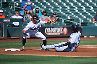 Salt River Rafters Ronaldo Hernandez (24), of the Tampa Bay Rays organization, slides into third base in front of Rylan Bannon (1) during the Arizona Fall League Championship Game against the Surprise Saguaros on October 26, 2019 at Salt River Fields at Talking Stick in Scottsdale, Arizona. The Rafters defeated the Saguaros 5-1. (Zachary Lucy/Four Seam Images)