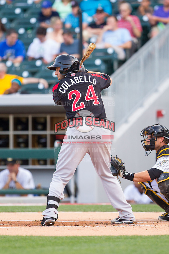 Chris Colabello (24) of the Rochester Red Wings at bat against the Charlotte Knights at BB&T Ballpark on June 5, 2014 in Charlotte, North Carolina.  The Knights defeated the Red Wings 7-6.  (Brian Westerholt/Four Seam Images)