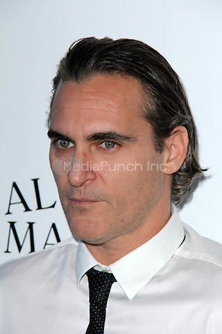 Joaquin Phoenix at the Irrational Man premiere at the WGA Theater in Beverly Hills, California on July 9, 2015. Credit: David Edwards/MediaPunch