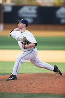 Georgetown Hoyas relief pitcher Tim Davis (28) in action against the Delaware Blue Hens at Wake Forest Baseball Park on February 13, 2015 in Winston-Salem, North Carolina.  The Blue Hens defeated the Hoyas 3-0.  (Brian Westerholt/Four Seam Images)