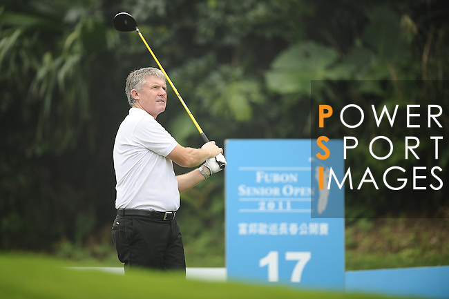TAIPEI, TAIWAN - NOVEMBER 18:  Terry Burgoyne of England tees off on the 17th hole during day one of the Fubon Senior Open at Miramar Golf & Country Club on November 18, 2011 in Taipei, Taiwan. Photo by Victor Fraile / The Power of Sport Images