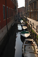 Moored boats in canal close to the stone Lions at Arsenale naval station, Venice, Italy, May 2007.