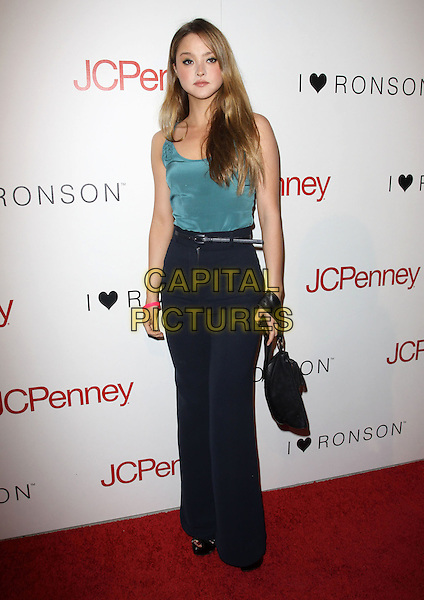 DEVON AOKI .Charlotte Ronson and JCPenney Spring Cocktail Jam held At The The Milk Studio, Los Angeles, California, USA, 4th May 2010..full length  blue green turquoise top trousers high waisted belt wide leg silk vest bag jeans .CAP/ADM/KB.©Kevan Brooks/AdMedia/Capital Pictures.