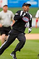 Antron Brown (2) of Team NHRA hustles around third base against Team NASCAR in the NASCAR vs NHRA Charity Softball Challenge at CMC-Northeast Stadium on April 17, 2013 in Kannapolis, North Carolina.  Team NHRA defeated Team NASCAR 19-5.  (Brian Westerholt/Four Seam Images)