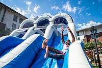 Quantez Perkins, a senior biochemistry major from Jackson, enjoys a water slide he helped set up for students in Mississippi State's College Ready program. College Ready provides incoming students with the opportunity to take freshman-level classes with reduced tuition and ease their transition to campus life.<br />