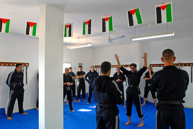 Palestinian policemen practice arresting methods during training at the police academy in the West Bank town of Jericho.