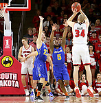VERMILLION, SD - JANUARY 24: Reed Tellinghuisen #23 and David Jenkins Jr. #5 from South Dakota State University try and intimidate the jumper of Nick Fuller #34 from the University of South Dakota during their game Wednesday night at the Sanford Coyote Sports Center in Vermillion, SD. (Photo by Dave Eggen/Inertia)