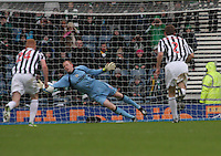 Craig Samson saves the penalty in the St Mirren v Celtic Scottish Communities League Cup Semi Final match played at Hampden Park, Glasgow on 27.1.13.