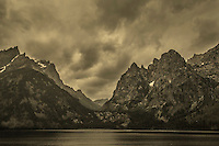 Dark clouds pass through Grand Teton National Park and Jenny Lake in Wyoming