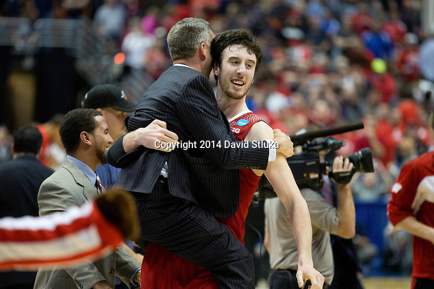 Wisconsin Badgers Frank Kaminsky picks up Athletic Communications Patrick Herb after the Western Regional Final NCAA college basketball tournament game against the Arizona Wildcats Saturday, March 29, 2014 in Anaheim, California. The Badgers won 64-63 (OT). (Photo by David Stluka)