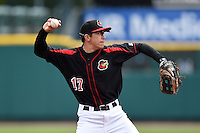 Rochester Red Wings shortstop Doug Bernier (17) throws to first during a game against the Louisville Bats on May 4, 2014 at Frontier Field in Rochester, New  York.  Rochester defeated Louisville 12-6.  (Mike Janes/Four Seam Images)