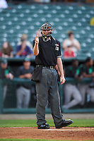Umpire Ryan Wilhelms makes a call during a game between the Dayton Dragons and Peoria Chiefs on May 6, 2016 at Dozer Park in Peoria, Illinois.  Peoria defeated Dayton 5-0.  (Mike Janes/Four Seam Images)