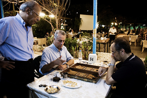 Men playing backgammon at the restaurant Chatila Bros. near the Corniche in Beirut.<br /> <br /> Des joueurs de backgammon au restaurant le Chatila Bros. pr&egrave;s de la Corniche &agrave; Beyrouth.