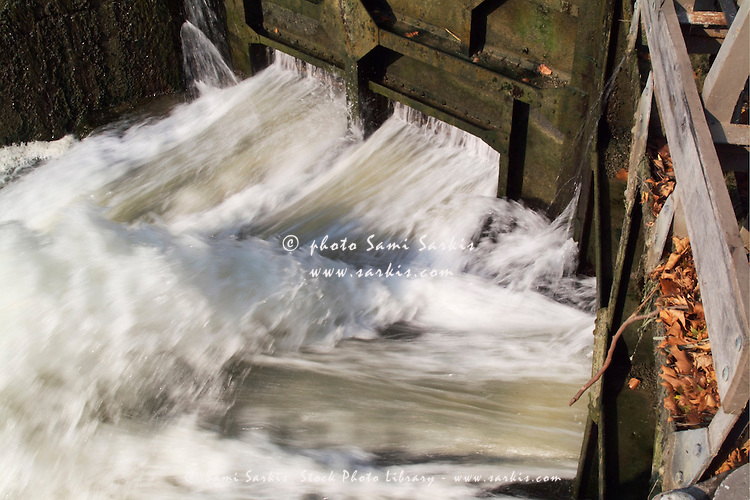Water pouring through floodgate, Fresquel Aqueduct, Canal du Midi, Carcassonne, France.