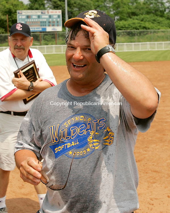 STRATFORD, CT - 11 JUNE 2005 -061105JS12--Seymour head coach Ken Pereiras wipes ice water off after getting doused by the players following their win over Daniel Hand High School to capture the Class L state championship Saturday at DeLuca Field in Stratford.  --Jim Shannon Photo--  are CQ