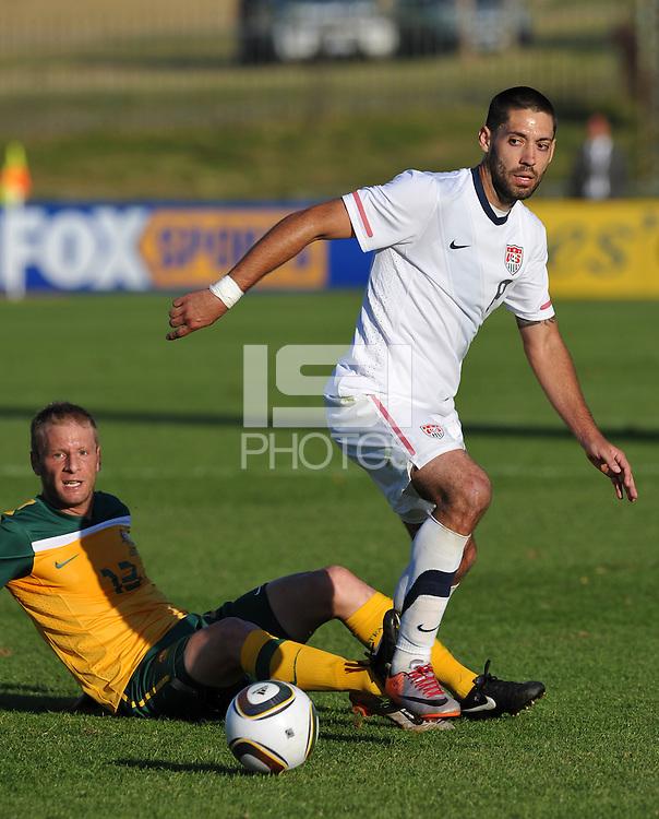 Clint Dempsey of USA and Vincenzo Grella of Australia...Football - International Friendly - USA v Australia - Ruimsig Stadium